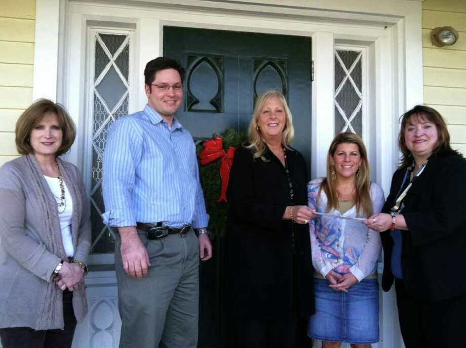 Pictured are members of the New Canaan Dept. of Human Services: Susan Klehm, Anthony Phillips, Director Carol McDonald, Jackie D'Louhy and 2011 Board of Realtors President AnnMarie Sementilli. Photo: Contributed Photo