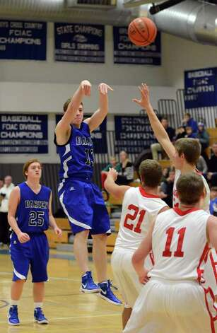 Darien's Liam Naughton (13) goes for a shot during the LaVista Memorial basketball tournament against Greenwich at Darien High School on Thursday, Dec. 29, 2011. Photo: Amy Mortensen / Connecticut Post Freelance