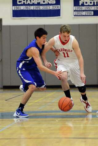 Darien's Matt Lee (3) snatches the ball away from Greenwich's Alex McMurray (11) during the LaVista Memorial basketball tournament at Darien High School on Thursday, Dec. 29, 2011. Photo: Amy Mortensen / Connecticut Post Freelance