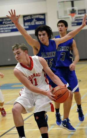Greenwich's Alex McMurray (11) controls the ball as Darien's Jonathan Dehlin (45) defends during the LaVista Memorial basketball tournament at Darien High School on Thursday, Dec. 29, 2011. Photo: Amy Mortensen / Connecticut Post Freelance