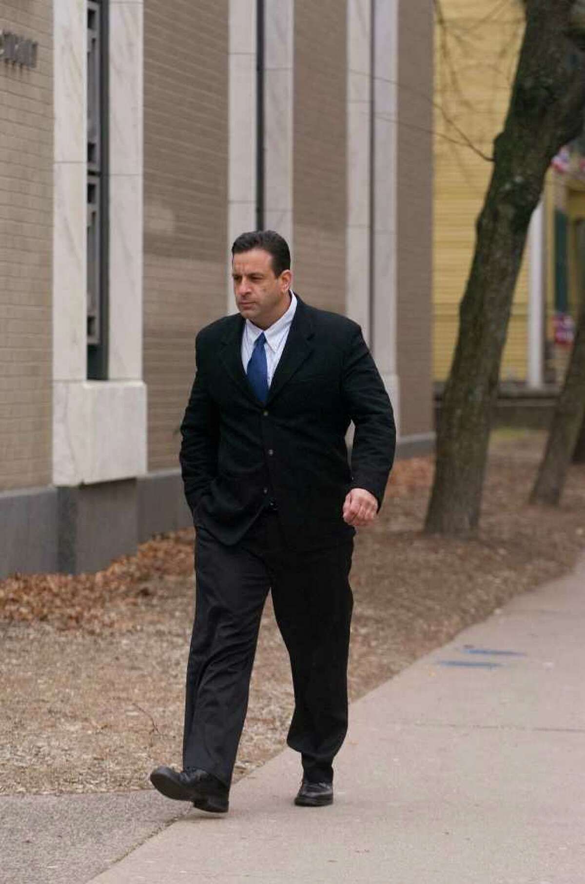 Mark Mansa walks to his hearing at the Abraham A. Ribicoff Federal Building and Courthouse in Hartford on Friday, Dec. 30, 2011. Mansa pleaded guilty to one count of conspiracy to distribute marijuana in excess of 100 kilograms between 2007 and 2011.