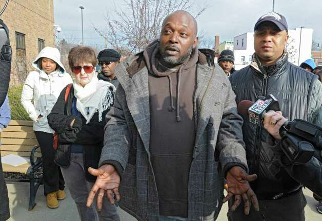 Sam Coleman, along with other Community group members, talk outside the Public Safety Building on Henry Johnson Blvd about the overnight police shooting that left a man dead Friday, Dec. 30, 2011 in Albany, N.Y. (Lori Van Buren / Times Union) Photo: Lori Van Buren