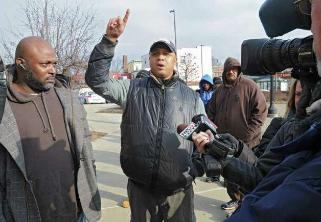Albany  council member Lester Freeman, along with other Community group members, talk outside the Public Safety Building on Henry Johnson Blvd about the overnight police shooting that left a man dead Friday, Dec. 30, 2011 in Albany, N.Y. Sam Coleman, on left, also spoke at the gathering. (Lori Van Buren / Times Union) Photo: Lori Van Buren