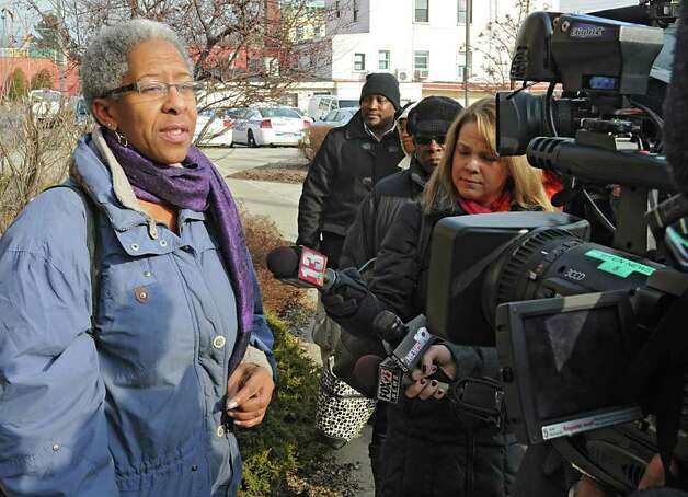ACPAC member Jacqui Williams, along with other Community group members, talk outside the Public Safety Building on Henry Johnson Blvd about the overnight police shooting that left a man dead Friday, Dec. 30, 2011 in Albany, N.Y. (Lori Van Buren / Times Union) Photo: Lori Van Buren