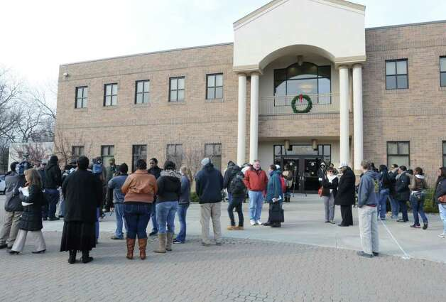 Community groups gather at the Public Safety Building on Henry Johnson Blvd to talk about the overnight police shooting that left a man dead Friday, Dec. 30, 2011 in Albany, N.Y. (Lori Van Buren / Times Union) Photo: Lori Van Buren