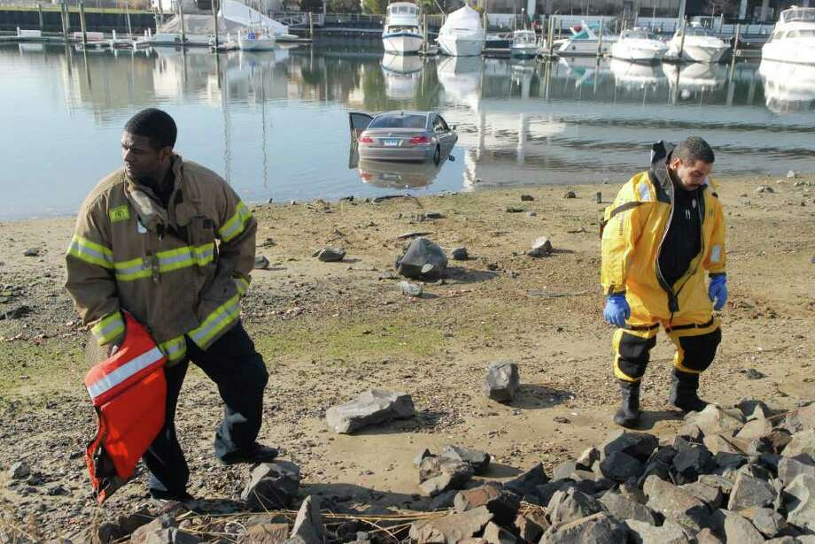 Cesar Rodriguez's car sits in the water at Cummings Beach in Stamford, Conn. after being pushed in in a alleged road rage incident on Friday December 30, 2011. Photo: Dru Nadler / Stamford Advocate Freelance