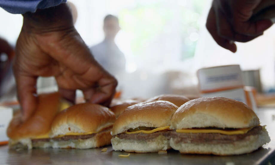 White Castle employees cook their slider burgers before delivering them.  Photo: Win McNamee, Win McNamee/Getty Images / 2011 Getty Images