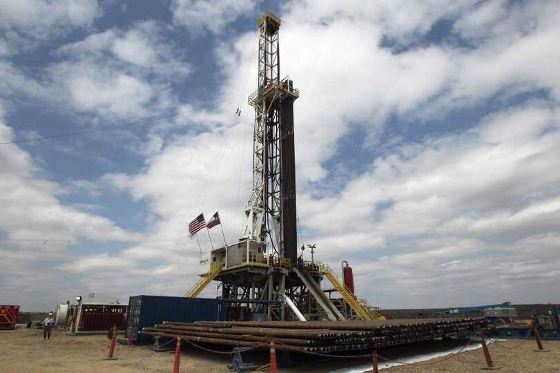 Drilling rigs like this one in McMullen county, Texas near Tilden are are becoming a common sight