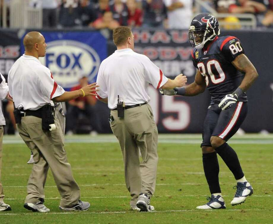 Houston's Andre Johnson had more than 1,200 yards receiving each of the past three seasons, but injuries have kept him to less than 500 in 2011. Photo: AP