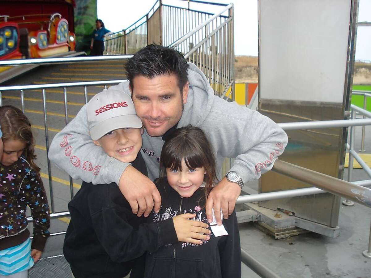 This undated image provided Tuesday April 5, 2011 by John Stow shows Bryan Stow holding his 12-year-old son and 8-year-old daughter. Bryan Stow, A Giants fan was beaten after last week Dodger home opener, has sustained brain damage as a result and remainin critical condition. The children are unidentified at the request of the source.