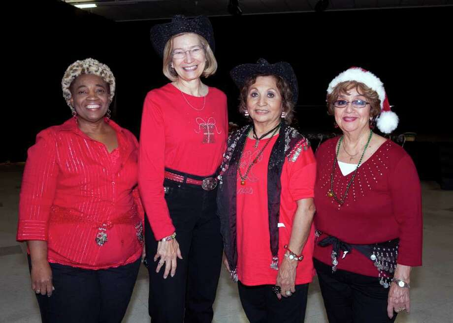 Vernice Miller (from left), Cathy Hoy, Mary Stahl and Tina Miranda get  together during the Methodist Healthcare 55 Plus holiday party at Tri  Point YMCA. Photo: For The  Express-News, Jamie Karutz / Special to the Express-News