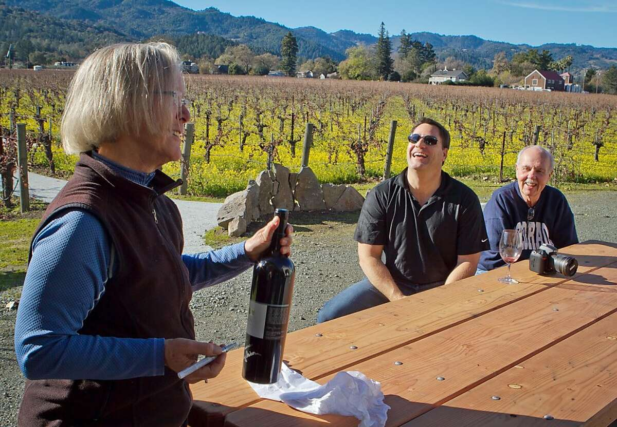 Winemaker Cathy Corison hands a signed magnum of Cabernet to Larry Wollert 1 & 2 at her winery in St. Helena, Calif., on Friday, December 16, 2011.