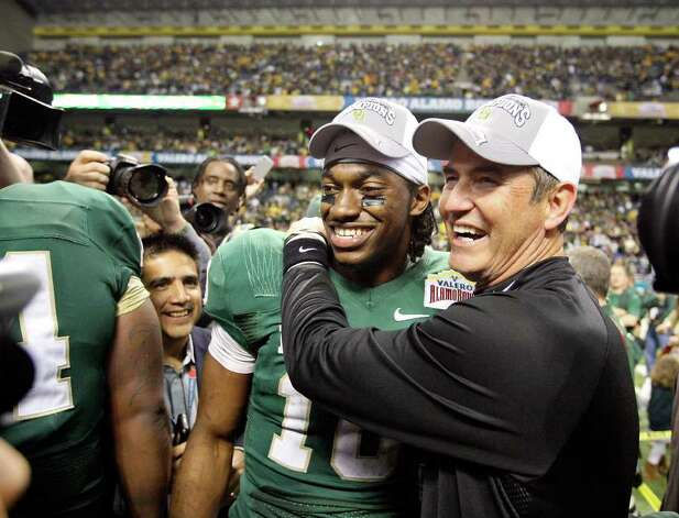 FOR SPORTS - Baylor's Robert Griffin III and Baylor head coach Art Briles are all smiles after the 2011 Valero Alamo Bowl against Washington Thursday Dec. 29, 2011 at the Alamodome in San Antonio,Tx. Baylor won 67-56. (PHOTO BY EDWARD A. ORNELAS/eaornelas@express-news.net) Photo: EDWARD A. ORNELAS, SAN ANTONIO EXPRESS-NEWS / SAN ANTONIO EXPRESS-NEWS (NFS)