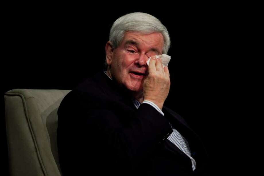 ANDREW BURTON: GETTY IMAGES MELANCHOLY: Republican presidential candidate Newt Gingrich wipes away a tear while speaking about his late mother during a forum on Friday in Des Moines. Photo: Andrew Burton / 2011 Getty Images