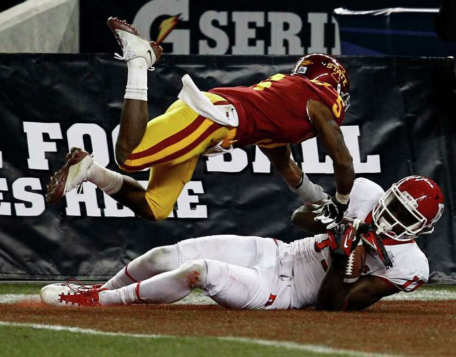 Rutgers' Brandon Coleman comes down with a touchdown grab in the fourth quarter despite the defense of Iowa State's Jeremy Reeves, essentially wrapping up Rutgers' second win of the season at Yankee Stadium. Photo: Jeff Zelevansky, Getty Images / 2011 Getty Images