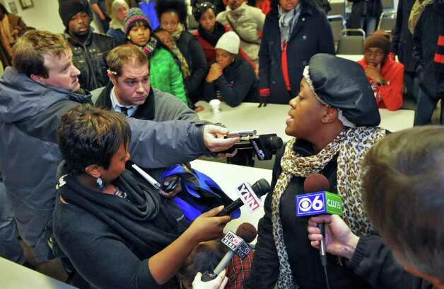 Eye witness to the shooting of Nahcream Moore, by police Thursday night, Willisa Marshall, 20,  speaks to the media following a police news conference Friday Dec. 30, 2011.  (John Carl D'Annibale / Times Union) Photo: John Carl D'Annibale / 10015954B