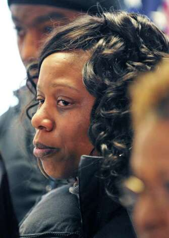 Mother of 19-year-old Nahcream Moore, killed by police Thursday night,  Davina Woodard, listens as Albany Police Chief Steven Krokoff speaks to the media and members of the community Friday Dec. 30, 2011.  (John Carl D'Annibale / Times Union) Photo: John Carl D'Annibale / 10015954B