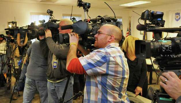 Television cameras turn from covering  Albany Police Chief Steven Krokoff to cover angry members of the community during a news conference Friday Dec. 30, 2011, about the police shooting of 19-year-old Nahcream Moore,Thursday night.   (John Carl D'Annibale / Times Union) Photo: John Carl D'Annibale / 10015954B