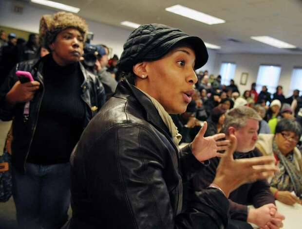 Community member Ann Ingram shouts at  Albany Police Chief Steven Krokoff during a news conference Friday Dec. 30, 2011, about the police shooting of 19-year-old Nahcream Moore,Thursday night.   (John Carl D'Annibale / Times Union) Photo: John Carl D'Annibale / 10015954B