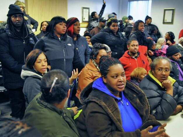 Community members listen as  Albany Police Chief Steven Krokoff speaks Friday Dec. 30, 2011, about the police shooting of 19-year-old Nahcream Moore,Thursday night.   (John Carl D'Annibale / Times Union) Photo: John Carl D'Annibale / 10015954B