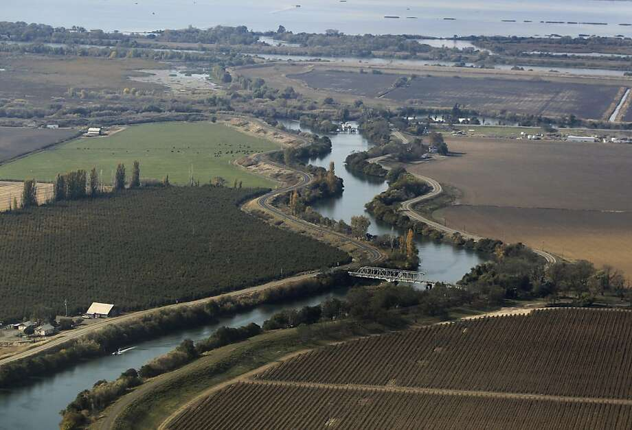 Fertile farmland is protected by levees lining a slough in the Sacramento-San Joaquin River Delta on Wednesday, Nov. 9, 2011. If built, the Peripheral Canal would divert fresh water to the south and could have a significant impact on the future of the delta, its wildlife and local farming. Photo: Paul Chinn, The Chronicle
