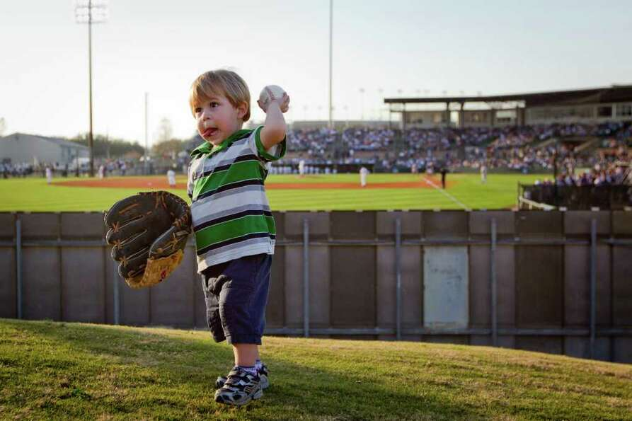 Feb. 18, 2011 | Grayson Hallmark, 2, tosses a ball on the outfield hill while playing catch with his