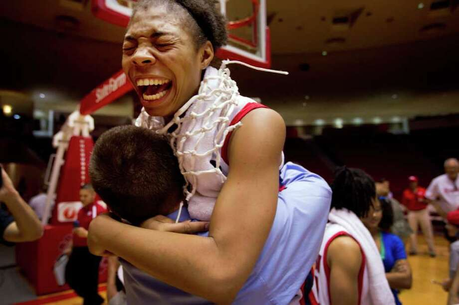 Feb. 20, 2011 | Houston Cougars forward Courtney Taylor (24) celebrates with head coach Todd Buchanan following the Cougars victory over UTEP in NCAA women's basketball action at Hofheinz Pavilion in Houston.  The Cougars, unbeaten in C-USA play, clinched the Conference USA regular season title outright with the 77-61 victory against the Miners. Houston also collected its 13th-consecutive win, which ties the school record set by the 2003-04 team. Photo: Smiley N. Pool, Houston Chronicle / © 2011  Houston Chronicle