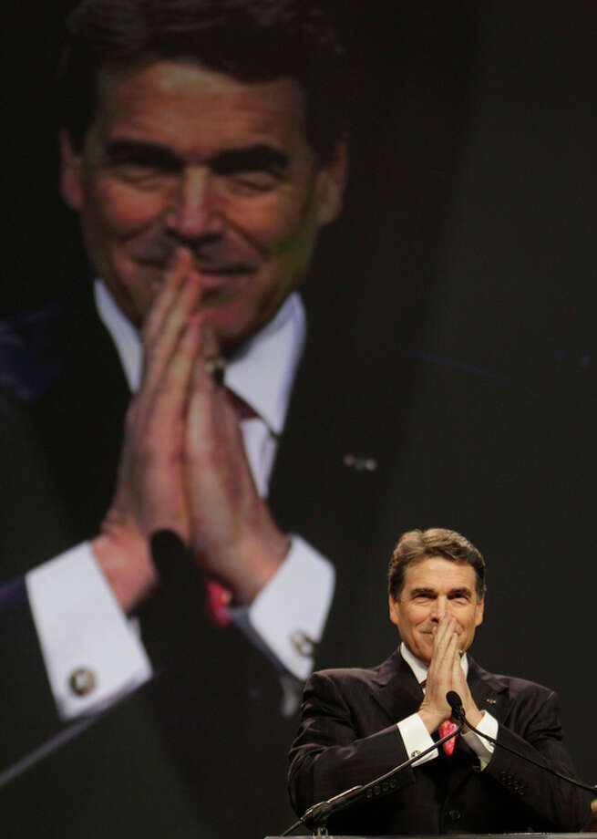 Aug. 6, 2011 | Texas Governor Rick Perry read scripture and gave a prayer during The Response: A Call To Prayer for a Nation in Crisis event at Reliant Stadium in Houston. The seven hour program of prayer and fasting was initiated by Texas Governor Rick Perry and funded by the American Family Association. Photo: Melissa Phillip, Houston Chronicle / © 2011 Houston Chronicle