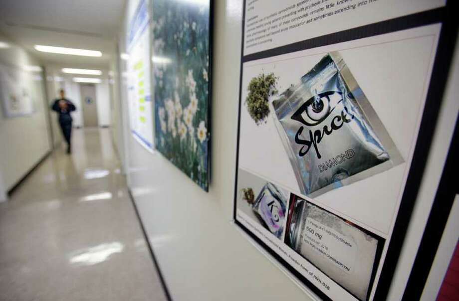 """GREGORY BULL : ASSOCIATED PRESS CRACKDOWN: A poster warning the drug known as """"spice"""" hangs on a wall at the Naval Hospital in San Diego. Probes of suspected users in the military have soared. Photo: Gregory Bull / AP"""