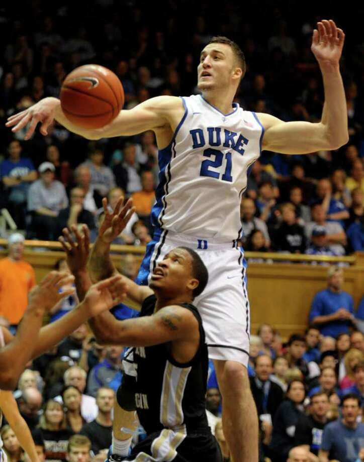 Duke's Miles Plumlee (21), who had a career-high 15 rebounds, knocks the ball away from Western Michigan's Mike Douglas. Photo: AP