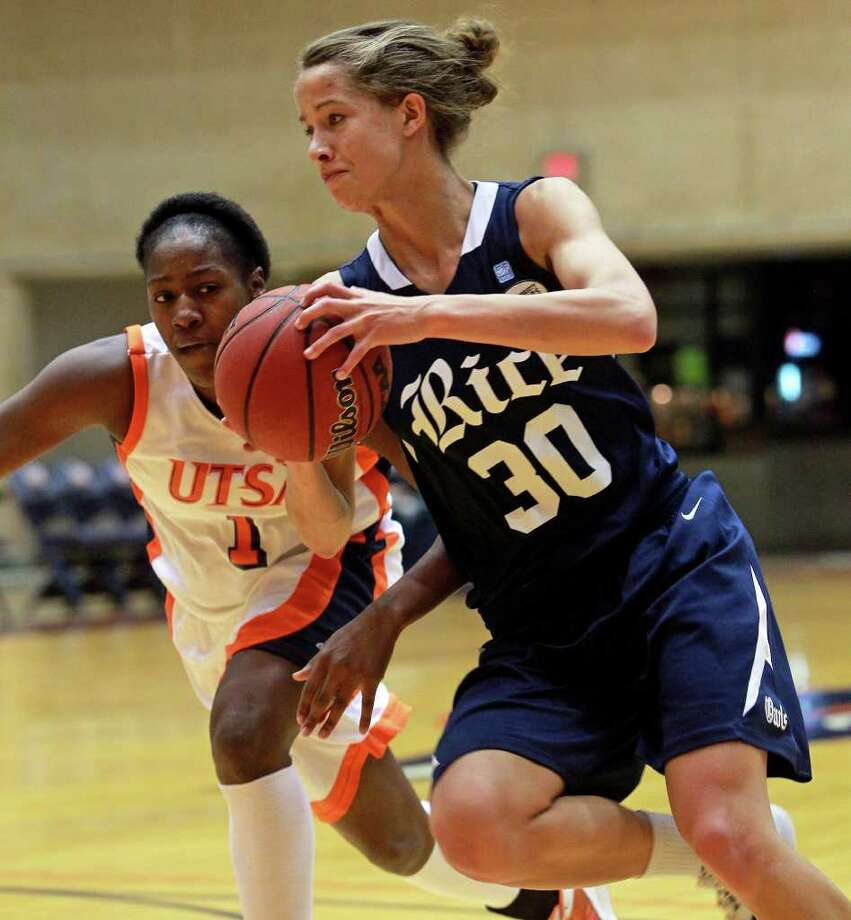Rice sophomore Jessica Kuster, who had 21 points and 21 rebounds, drives on UTSA's Judy Jones on Friday at the Convocation Center. Photo: TOM REEL, SAN ANTONIO EXPRESS-NEWS / © 2011 San Antonio Express-News