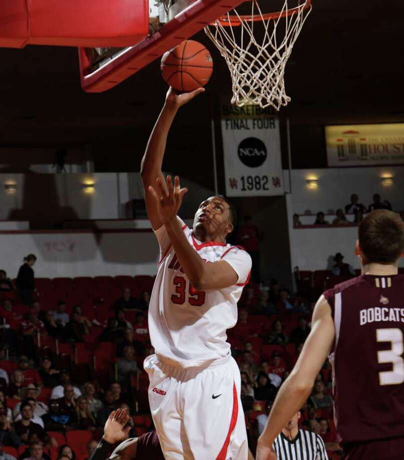 Houston's TaShawn Thomas (35) puts up a short jump hook during the first half of an NCAA basketball game between Houston and Texas State Friday, December 30, 2011 in Houston. Photo: Bob Levey, Houston Chronicle / ©2011 Bob Levey