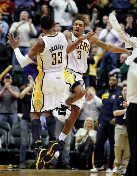 Pacers forward Danny Granger and guard George Hill rejoice after one of Granger's baskets against the Cavs. Photo: AP