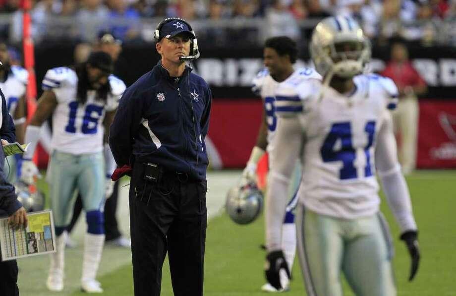 ROSS D. FRANKLIN: AP STANDING TALL: Win or lose Sunday, Cowboys coach Jason Garrett will keep his job, owner Jerry Jones says. Photo: Ross D. Franklin / AP