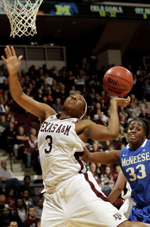 Texas A&M's Kelsey Bone (3) reaches for a rebound as McNeese State's Adrienne Minor (33) closes in during the second half of an NCAA college basketball game Friday, Dec. 30, 2011, in College Station, Texas. (AP Photo/David J. Phillip) Photo: David J. Phillip / AP