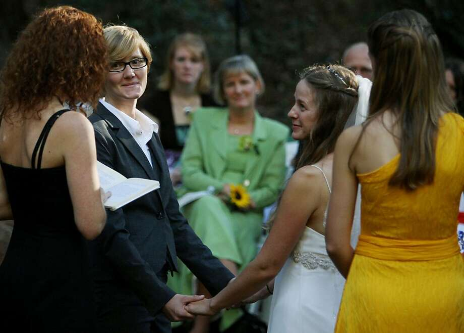 Andrea Cernusak, 30, and Karina Keethe, 29, hold hands during their Oct. 2008 ceremony at Stern Grove in the Sunset District. The site can be reserved in six-hour slots for $1140, which includes use of the outdoor grounds and a two-story Victorian reception venue. Photo: Mike Kepka, The Chronicle