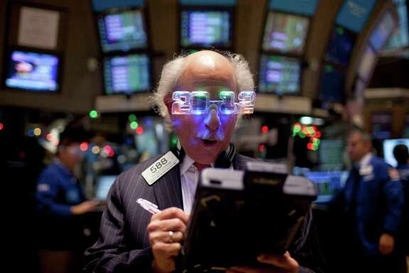 Jin Lee : Bloomberg READY FOR WHAT'S NEXT: A trader thinks ahead Friday on the floor of the New York Stock Exchange. The S&P 500 index finished the year virtually unchanged. Concern over Europe's debt crisis tempers optimism for the U.S. economy in 2012.