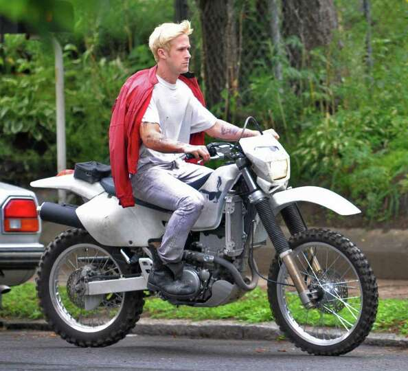 Ryan Gosling rides a motorcycle during filming for the movie ?The Place Beyond the Pines? on Watt