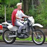 Ryan Gosling rides a motorcycle during filming for the movie ?The Place Beyond the Pines? on Watt Street in Schenectady Tuesday Aug. 9, 2011.   (John Carl D'Annibale / Times Union)