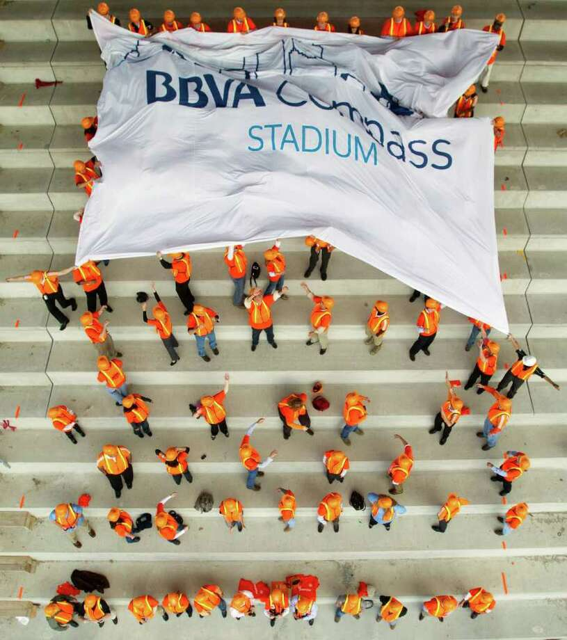 Dec. 14, 2011 | A banner is unfurled by Houston Dynamo fans and staff during a naming ceremony for BBVA Compass Bank Stadium in Houston. Photo: Brett Coomer, Houston Chronicle / © 2011 Houston Chronicle