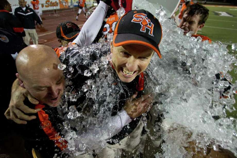 Dec. 16, 2011 | Sam Houston State head coach WIllie Fritz, center, is dunked by a bucket of ice water after the Bearkats beat Montana in the NCAA Football Championship Subdivision semifinal playoff game at Bowers Stadium in Huntsville, Texas. Sam Houston beat Montana 31-28 to advance to the FCS championship game. Photo: Brett Coomer, Houston Chronicle / © 2011 Houston Chronicle