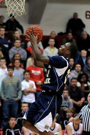 Fairfield of Notre Dame's #11 Daniel Upchurch goes up to the hoop, during boys basketball action against Fairfield Warde from the Fairfield Prep Holiday Classic at Fairfield University in Fairfield, Conn. on Friday December 30, 2011. Photo: Christian Abraham / Connecticut Post