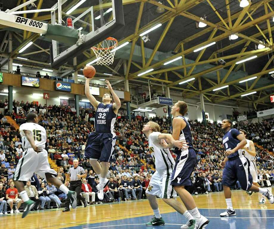BYU's Jimmer Fredette, a graduate of Glens Falls, goes up for a lay-up during a sold out basketball game against Vermont at the Glens Falls Civic Center in Glens Falls, NY.  (Lori Van Buren / Times Union) Photo: Lori Van Buren / 00011333A