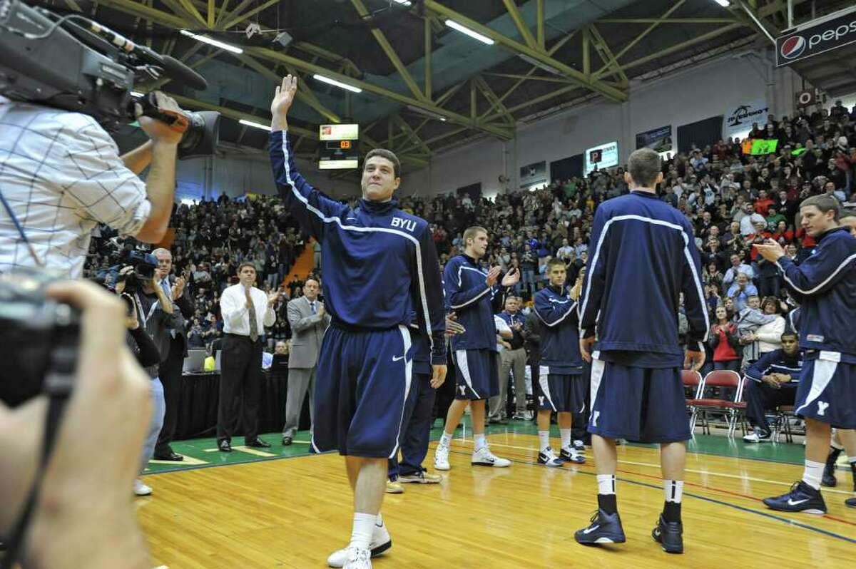 BYU's Jimmer Fredette, a graduate of Glens Falls, waves to his fans before a basketball game against Vermont at the Glens Falls Civic Center in Glens Falls, NY. (Lori Van Buren / Times Union)