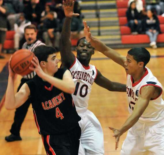 Albany Academy's #4 Jay Puleo, left, gets double teamed by Schenectady's #10 Jallah Tarver and #12 R