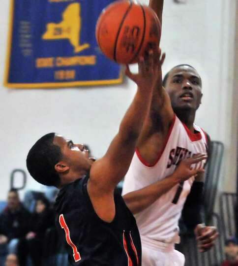 Albany Academy's #1 Darrien White, left, and  Schenectady's # 1Shateek Garlic during the title game