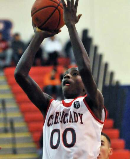 Schenectady's #00 Darius Macon goes to the basket against Albany Academy in the title game of the Hi