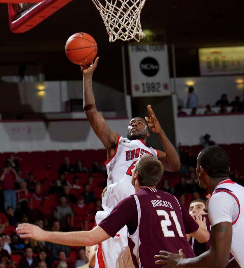 Houston's Jonathan Simmons (23) shoots over Texas State's Matt Staff (21) during the first half of an NCAA basketball game between Houston and Texas State Friday, December 30, 2011 in Houston. Photo: Bob Levey, Houston Chronicle / ©2011 Bob Levey
