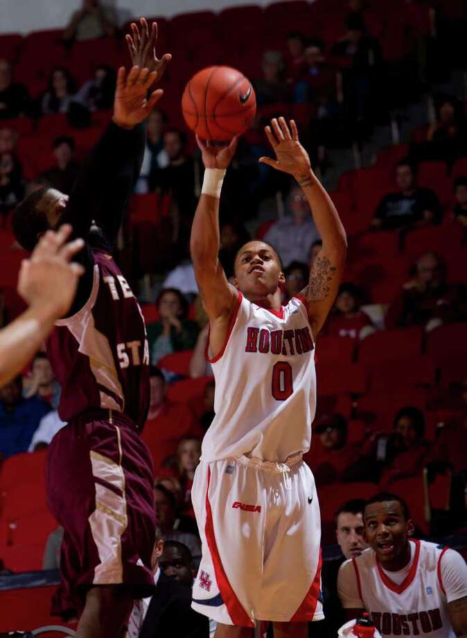 Houston's Jospeh Young (0) puts up a three point shot from the corner during the second half of an NCAA basketball game between Houston and Texas State Friday, December 30, 2011 in Houston. Houston defeated Texas State 94-71. Photo: Bob Levey, Houston Chronicle / ©2011 Bob Levey