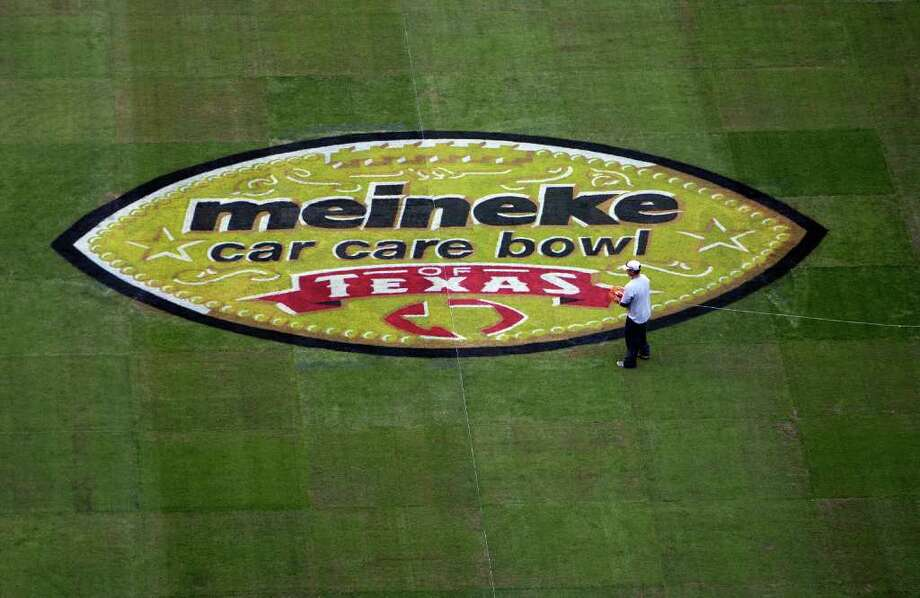 James Nielsen : Chronicle GETTING READY: The Meineke Car Care Bowl of Texas field logo is in place Friday at Reliant Stadium as workers continued final preparations for today's game between Texas A&M and Northwestern. Photo: James Nielsen / © 2011 Houston Chronicle